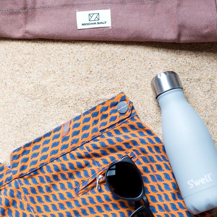 water bottle on sand